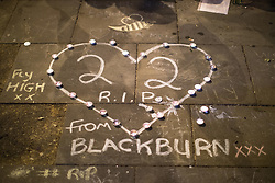 "© Licensed to London News Pictures . 29/05/2017 . Manchester , UK . Candles arranged in to a heart shape around a chalk message reading "" 22 R.I.P "" as a vigil is held in St Ann's Square in Manchester City Centre , exactly a week after Salman Abedi murdered 22 and injured another 64 at an Ariana Grande concert at Manchester Arena . Photo credit: Joel Goodman/LNP"
