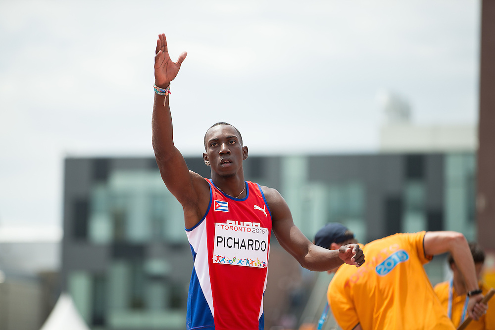 Pedro Pablo Pichardo of Cuba celebrates his gold medal win in the men's triple jump competition at CIBC Athletics Stadium during the 2015 Pan American Games in Toronto, Canada, July 24,  2015.  AFP PHOTO/GEOFF ROBINS