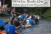 Canoers from 90 teams fill the AuSable River at the starting line of the 64th AuSable River Canoe Marathon.