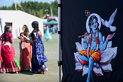 © Licensed to London News Pictures. 02/09/2018. WATFORD, UK.  An icon of Lord Krishna (R) is seen on a tent as thousands of devotees attend the biggest Janmashtami festival outside of India at the Bhaktivedanta Manor Hare Krishna Temple in Watford, Hertfordshire.  The event, which celebrates the birth of Lord Krishna, includes a cultural and spiritual festival at a property donated to the Hare Krishna movement by ex Beatle George Harrison.  Photo credit: Stephen Chung/LNP