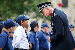 © Licensed to London News Pictures. 03/08/2015. London, UK. Metropolitan Police Commissioner Bernard Hogan-Howe meeting volunteer police cadets at a parade for the capital's young police volunteers in Trafalgar Square, London on Monday, August 3, 2015. Photo credit: Tolga Akmen/LNP