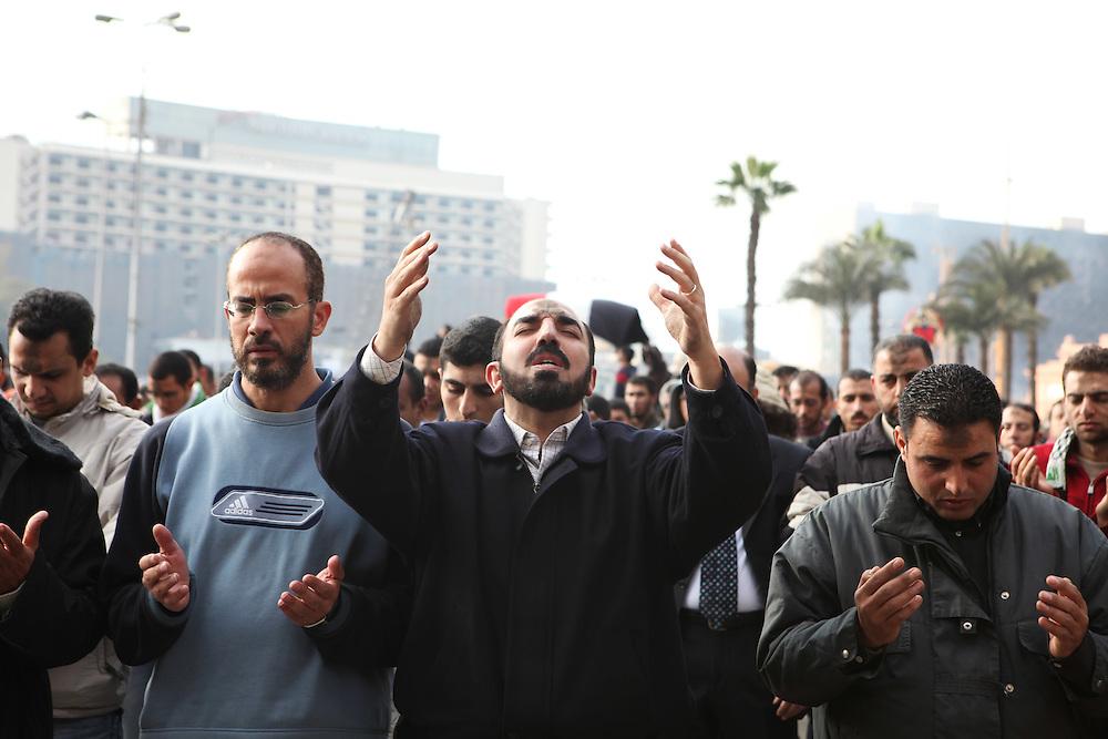 Protesters praying at Cairo's main Tahrir (Liberation) Square. .
