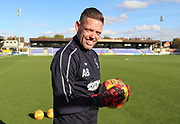AFC Wimbledon goalkeeping coach Ashley Bayes with new red gloves during the EFL Sky Bet League 1 match between AFC Wimbledon and Shrewsbury Town at the Cherry Red Records Stadium, Kingston, England on 3 November 2018.