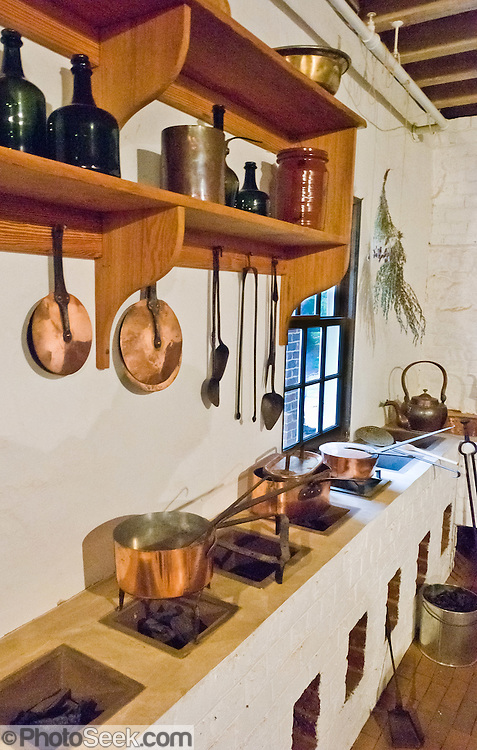Old style country kitchen, wood-fired stoves, copper pots at ...
