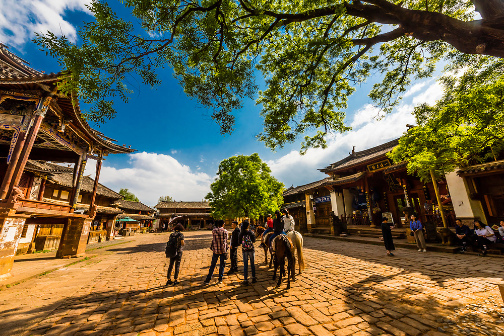 Sideng Square in the market town of Shaxi, on the Tea Horse Caravan Road, which links Southern Yunnan to Tibet and Burma and retains its position as one of the best preserved historic market hubs today.
