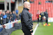 Walsalls manager Jon Whitney watching his team warm up before the EFL Sky Bet League 1 match between Walsall and Peterborough United at the Banks's Stadium, Walsall, England on 18 February 2017. Photo by Jacqueline Theodosi.