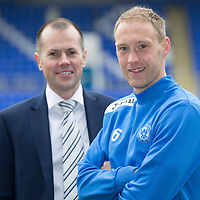 Launch of Steven Anderson's Testimonial....03.04.14<br /> Steven Anderson pictured at McDiarmid Park where his testimonial was launched to mark his ten years with St Johnstone he is pictured with Dave Ritchie Testimonial Committee Chairman<br /> Picture by Graeme Hart.<br /> Copyright Perthshire Picture Agency<br /> Tel: 01738 623350  Mobile: 07990 594431