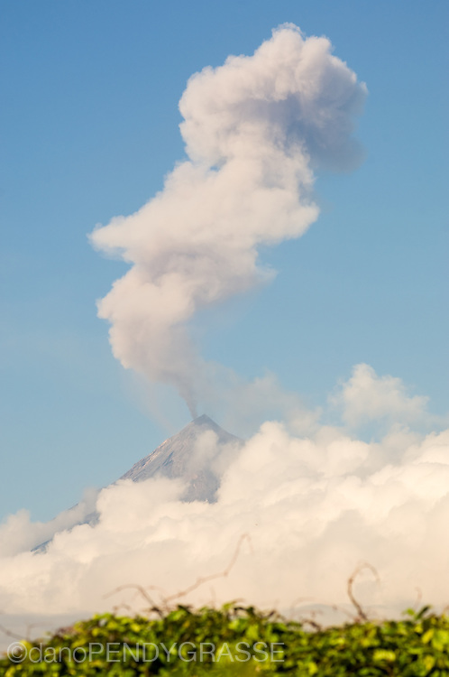 Volcan de Fuego vents steam and dust over the UNESCO world heritage site town of Antigua, Guatemala.