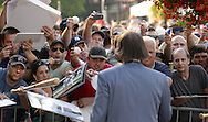 COOPERSTOWN, NY - JULY 26:  Fans call out for autographs as Hall of Famer Dennis Eckersley abliges  during the annual Parade of Legends down Main Street in Cooperstown, New York on July 26, 2014.