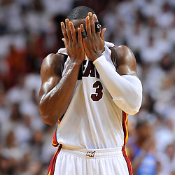Jun 17, 2012; Miam, FL, USA; Miami Heat shooting guard Dwyane Wade (3) reacts during the second quarter in game three in the 2012 NBA Finals against the Oklahoma City Thunder at the American Airlines Arena. Mandatory Credit: Derick E. Hingle-US PRESSWIRE