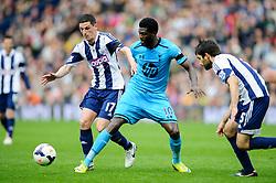 Emmanuel Adebayor (TOG) of Tottenham Hotspur is challenged by Graham Dorrans (SCO) of West Brom - Photo mandatory by-line: Rogan Thomson/JMP - 07966 386802 - 12/04/2014 - SPORT - FOOTBALL - The Hawthorns Stadium - West Bromwich Albion v Tottenham Hotspur - Barclays Premier League.