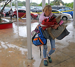 September 9, 2017 - Key West, Florida, U.S. - A Key West resident carries bedding and supplies into a shelter at Key West High School in Key West, Fla., on Saturday. Hurricane Irma is approaching the Florida Keys, with many residents refusing to be evacuated. (Credit Image: © Charles Trainor Jr/TNS via ZUMA Wire)