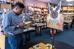 """© Licensed to London News Pictures. 31/07/2016. London, UK.  Fans of the Harry Potter books series visit Waterstones bookshop in Harrow to buy the """"Harry Potter and the Cursed Child"""", the script, in book form, of the play by JK Rowling. Photo credit : Stephen Chung/LNP"""