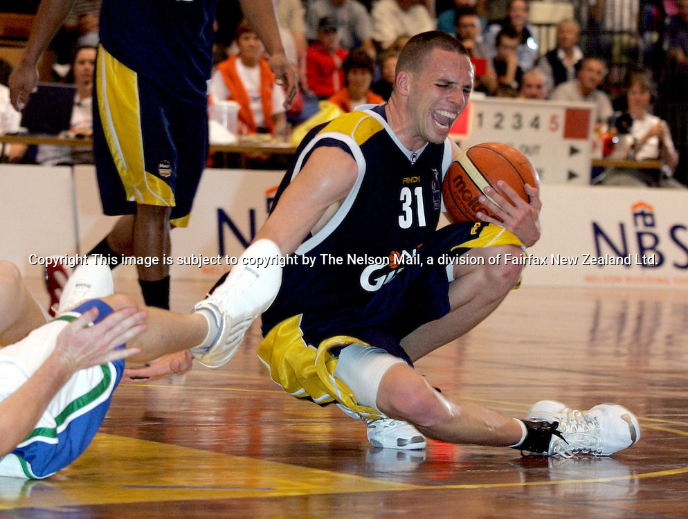 Nelson Giants Adam Spanich, collapses onto the floor of the Traflagar Centre during the basketball game against the Auckland Stars at the Trafalgar Centre, won by Auckland 88-74. 01/04/200596173Martin de RuyterNelsonThis image is subject to copyright by The Nelson Mail, a division of Fairfax New Zealand Ltd.
