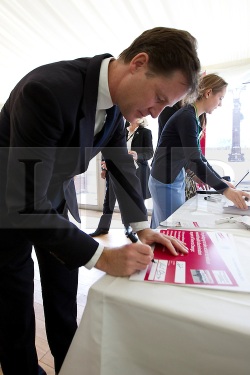 © Licensed to London News Pictures. 10/10/2013. London, UK. The deputy prime minister, Nick Clegg, signs a pledge at a Parliamentary reception hosted by mental health charities 'Time to Change', 'Mind' and 'Rethink Mental Illness' in London today (10/10/2013). The event held on 'World Mental Health Day' saw the Deputy Prime Minister, Nick Clegg, and the Care and Support Minister, Norman Lamb, joined by cross party MP's and peers, reinforce the need to tackle the stigma and discrimination surrounding mental health problems.  Photo credit: Matt Cetti-Roberts/LNP