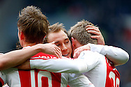 Onderwerp/Subject: Ajax - Eredivisie<br /> Reklame:  <br /> Club/Team/Country: <br /> Seizoen/Season: 2012/2013<br /> FOTO/PHOTO: Viktor FISCHER (R) of Ajax celebrating his goal with Siem DE JONG (L) of Ajax and Christian ERIKSEN ( Christian Dannemann ERIKSEN ) (C) of Ajax. (Photo by PICS UNITED)<br /> <br /> Trefwoorden/Keywords: <br /> #02 $94 ±1355239233217 ±1355239233217<br /> Photo- & Copyrights © PICS UNITED <br /> P.O. Box 7164 - 5605 BE  EINDHOVEN (THE NETHERLANDS) <br /> Phone +31 (0)40 296 28 00 <br /> Fax +31 (0) 40 248 47 43 <br /> http://www.pics-united.com <br /> e-mail : sales@pics-united.com (If you would like to raise any issues regarding any aspects of products / service of PICS UNITED) or <br /> e-mail : sales@pics-united.com   <br /> <br /> ATTENTIE: <br /> Publicatie ook bij aanbieding door derden is slechts toegestaan na verkregen toestemming van Pics United. <br /> VOLLEDIGE NAAMSVERMELDING IS VERPLICHT! (© PICS UNITED/Naam Fotograaf, zie veld 4 van de bestandsinfo 'credits') <br /> ATTENTION:  <br /> © Pics United. Reproduction/publication of this photo by any parties is only permitted after authorisation is sought and obtained from  PICS UNITED- THE NETHERLANDS