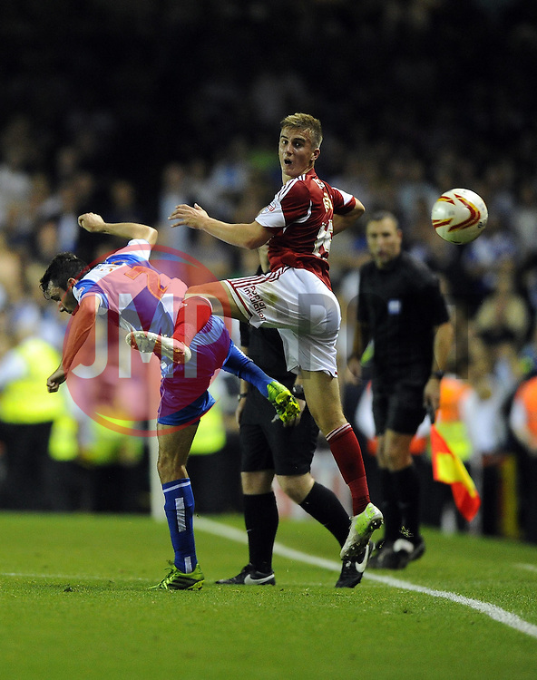 Bristol City's Joe Bryan battles for the high ball with Bristol Rovers' Michael Smith  - Photo mandatory by-line: Joe Meredith/JMP - Tel: Mobile: 07966 386802 04/09/2013 - SPORT - FOOTBALL -  Ashton Gate - Bristol - Bristol City V Bristol Rovers - Johnstone Paint Trophy - First Round - Bristol Derby