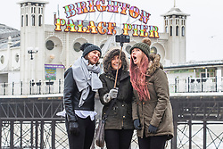 © Licensed to London News Pictures. 22/02/2020. Brighton, UK. Members of the public brave the cold weather and strong winds to take a selfie on the beach in Brighton and Hove. Photo credit: Hugo Michiels/LNP