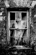 The ancient window of an abandoned Irish stone house.
