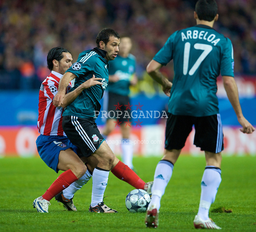 MADRID, SPAIN - Wednesday, October 22, 2008: Liverpool's Javier Mascherano and Club Atletico de Madrid's Luis Garcia during the UEFA Champions League Group D match at the Vicente Calderon. (Photo by David Rawcliffe/Propaganda)