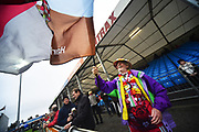 A Harlequins fan waving a flag before the Aviva Premiership match between Exeter Chiefs and Harlequins at Sandy Park, Exeter, United Kingdom on 19 November 2017. Photo by Graham Hunt.