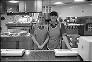 Two counter girls in uniform, UK, 1980s.