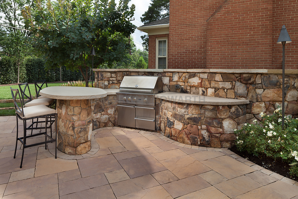 1945 MacArthur Rear patio with outdoor kitchen and fire pit