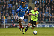 Portsmouth Midfielder, Jamal Lowe (10) gets away from Peterborough United Midfielder, Joe Ward (15) during the EFL Sky Bet League 1 match between Portsmouth and Peterborough United at Fratton Park, Portsmouth, England on 30 April 2019.