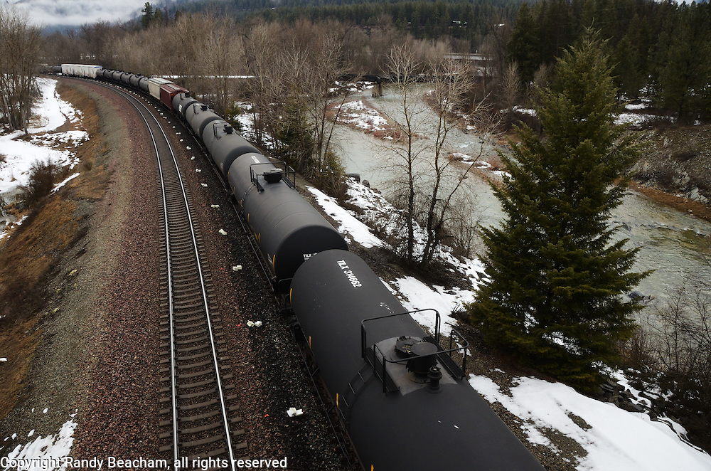 Oil tank cars on a BNSF train by the Fisher River near Libby in northwest Montana.