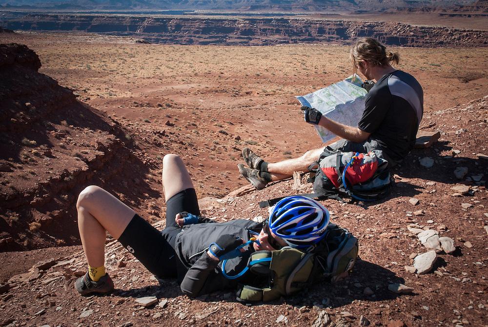 Mountian bikers consult thier topo maps while touring the White Rim Trail near Moab, Utah.