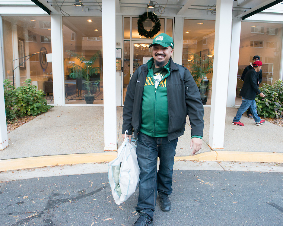 December 5, 2015 - Fairfax, VA - A day in the life of &quot;Doc Nix,&quot; aka Dr. Michael Nickens, the Director of the Athletic Bands for George Mason University. Leaving his apartment building en route to Mason before the game.<br /> <br /> Photo by Susana Raab