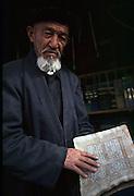 Imam and Koran, Kashgar, Xinjiang<br />Picture Credit: Dermot Tatlow