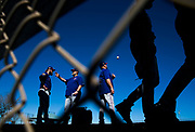 Texas Rangers starting pitcher Andrew Cashner (54, left) talks to pitching coach Doug Brocail (46) while bullpen coach Brad Holman (40) tosses a ball and other pitchers walk to their next drill during a spring training workout at the team's training facility on Tuesday, February 15, 2017 in Surprise, Arizona. (Ashley Landis/The Dallas Morning News)