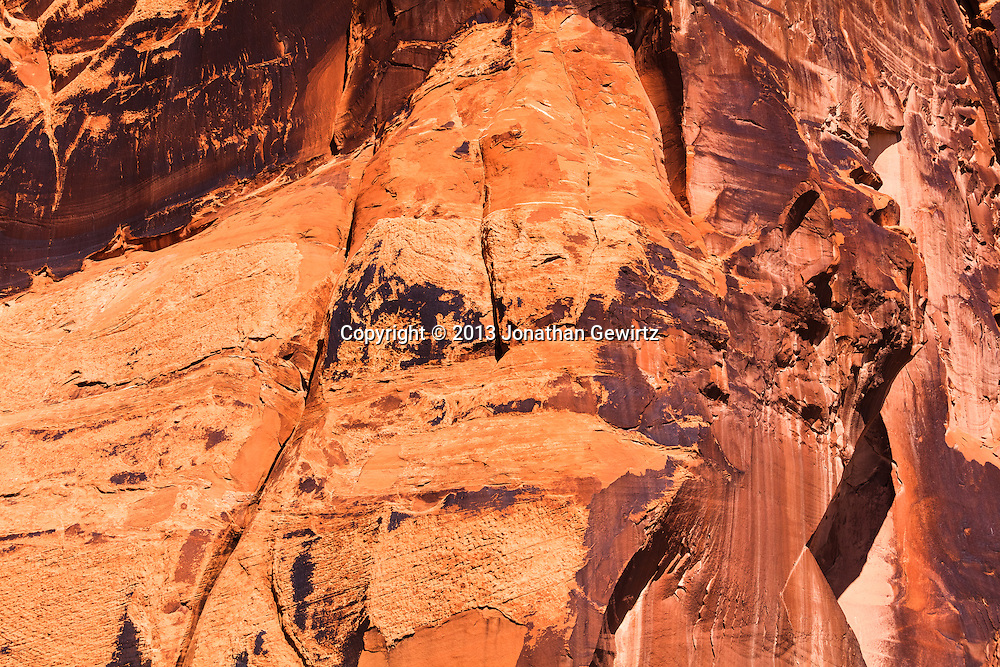 """Desert varnish"" on rock canyon walls along Utah Highway 279 which runs along the Colorado River near Moab, Utah. WATERMARKS WILL NOT APPEAR ON PRINTS OR LICENSED IMAGES."