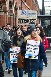 """St Pancras, London, January 16th 2016. Dozens of protesters hold an """"emergency demonstration and die-in"""" as France prepares to bulldoze the Jungle Camp at Calais. PICTURED: Protesters march along the side of St Pancras station as they look for somewhere to enter. ///FOR LICENCING CONTACT: paul@pauldaveycreative.co.uk TEL:+44 (0) 7966 016 296 or +44 (0) 20 8969 6875. ©2016 Paul R Davey. All rights reserved."""