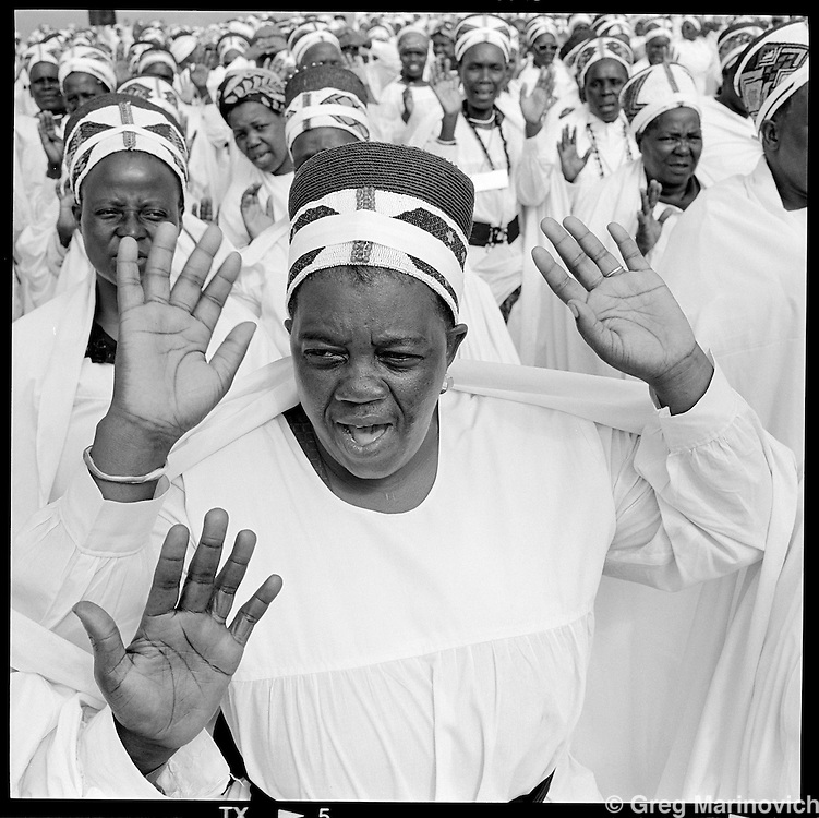Married women  of the Nazareth baptist Church pray at the church headquarters near KwaMashu, KwaZulu Natal, 1998. The founder Isaiah Shembe is seen as a spiritual descendent of Moses and Jesus, and th church embraces traditional Zulu values and customs. Photo Greg Marinovich