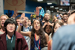 13 December 2019, Madrid, Spain: Young people chant and raise their hands, in an action at COP25. As COP25 is about to draw to a close, hundreds of young people mobilize through Fridays for Future in a strike for the climate, inside and outside the venue of COP25 in Madrid, calling for urgent action for climate justice.