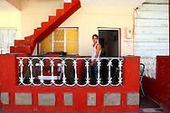 Barbershop on a house porch in Bauta, Artemisa, Cuba.