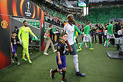 Paul Pogba Midfielder of Manchester United with mascot walks onto the pitch during the Europa League match between Saint-Etienne and Manchester United at Stade Geoffroy Guichard, Saint-Etienne, France on 22 February 2017. Photo by Phil Duncan.