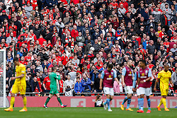 Liverpool supporters look dejected in the stands after their side squander Aston Villa late opportunity before losing the match 2-1 after Aston Villa win the match 2-1 to reach the 2015 FA Cup Final - Photo mandatory by-line: Rogan Thomson/JMP - 07966 386802 - 19/04/2015 - SPORT - FOOTBALL - London, England - Wembley Stadium - Aston Villa v Liverpool - FA Cup Semi Final.