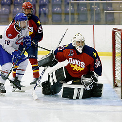 KINGSTON, ON  - FEB 22,  2018: Ontario Junior Hockey League game between the Kingston Voyageurs and the Wellington Dukes. Jonah Capriotti #30 of the Wellington Dukes and Rob Clerc #18 of the Kingston Voyageurs keep an eye on the puck during the third period.<br /> (Photo by Ian Dixon / OJHL Images)