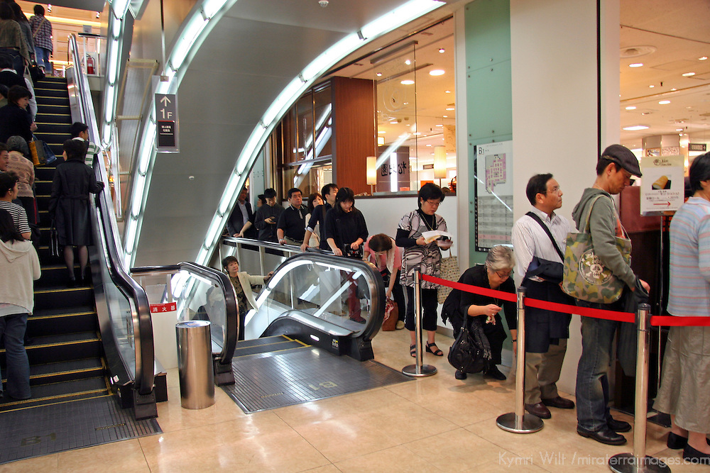 Asia, Japan, Tokyo. Shoppers queue up in an orderly fashion in a Tokyo Department Store.