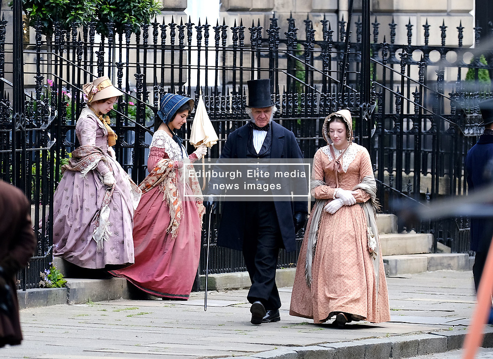 """Moray Place in Edinburgh's Georgian old town was turned into 19th century London for Julian Fellowes' new ITV show """"Belgravia"""".<br /> <br /> Pictured: Extras have a break between takes<br /> <br /> Alex Todd 