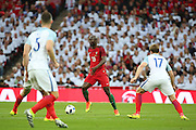 Portugal midfielder, Danilo (13) trying to find a way through a congested midfield during the Friendly International match between England and Portugal at Wembley Stadium, London, England on 2 June 2016. Photo by Matthew Redman.