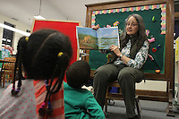Families were invited out Wednesday evening for stories, arts and crafts by the Blackstone Library located at 4904 S. Lake Park Ave.<br /> <br /> 0661 – Librarian, Sally Jones reads stories to the kids.