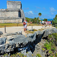 Tourists Exploring the Mayan Ruins in Tulum, Mexico <br /> The Mayan ruins at Tulum are located about 80 miles from Cancun. This historic attraction is visited by about two million people a year, making it Mexico&rsquo;s third most popular archaeological site.  So if you want to avoid throngs of people, it is best to arrive early in the morning. You will also avoid the afternoon heat.