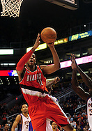 Dec. 10 2010; Phoenix, AZ, USA; Portland Trailblazers forward LaMarcus Aldridge (12) puts up the ball on the court against the Phoenix Suns at the US Airways Center. The Trailblazers defeated the Suns 101-94. Mandatory Credit: Jennifer Stewart-US PRESSWIRE..