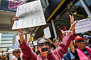 "25 MAY 2014 - BANGKOK, THAILAND:  Thai ""Red Shirt"" protestors opposed to the military junta at a demonstration in Bangkok. Public opposition to the military coup in Thailand grew Sunday with thousands of protestors gathering at locations throughout Bangkok to call for a return of civilian rule and end to the military junta.    PHOTO BY JACK KURTZ"