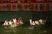 Water Puppet Theatre. Rowing boat competition.