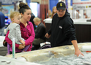 WARMINSTER, PA - OCTOBER 11: From left, Macie Mercogliana, 2, Megan Mercogliana and Steve Mercogliana of Warminster, Pennsylvania look at a jacuzzi at the Bucks Montco Home at the Sportsplex October 11, 2014 in Warminster, Pennsylvania. (Photo by William Thomas Cain/Cain Images)